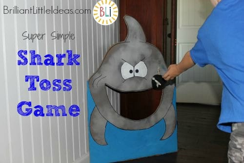 DIY Shark Toss game is a great summer diy craft to keep your kids busy. Come see how super simple it is to make it!