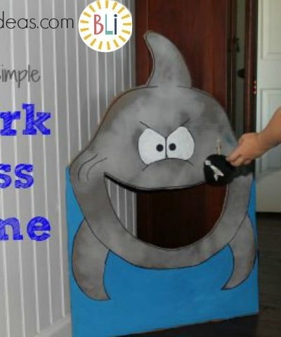 DIY shark toss game. Is a Great game for Ocean theme party, Shark theme, VBS, or a rainy day activity. Quick to make & easy game that all kids love.