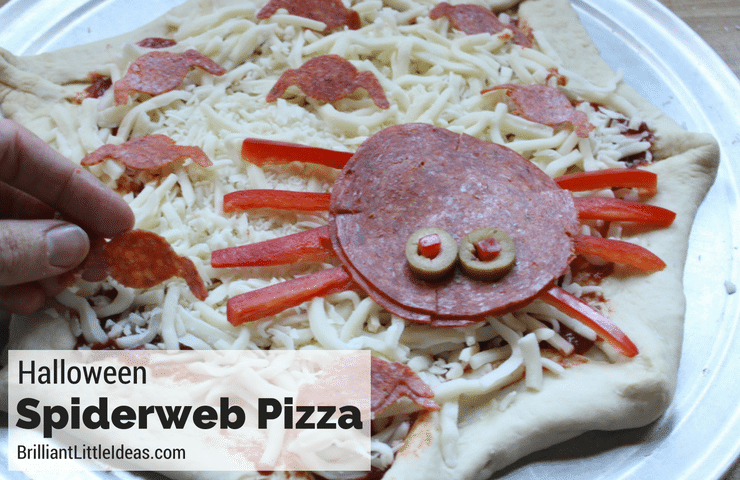 I swear this is the cutest Homemade Halloween Spiderweb Pizza. I can't wait to make this kid recipe with my son later he loves homemade pizza Halloween food